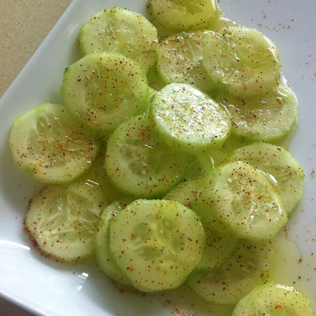 This easy, crisp cucumber salad is simple and simply perfect- just add lemon juice, olive oil, salt and pepper and chile powder to cut cucumbers