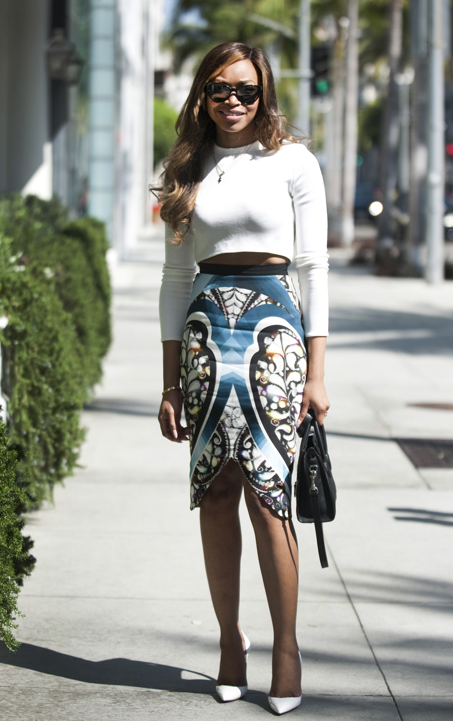 Titi Michael, 24, with a Celine bag and a Peter Pilowto skirt.