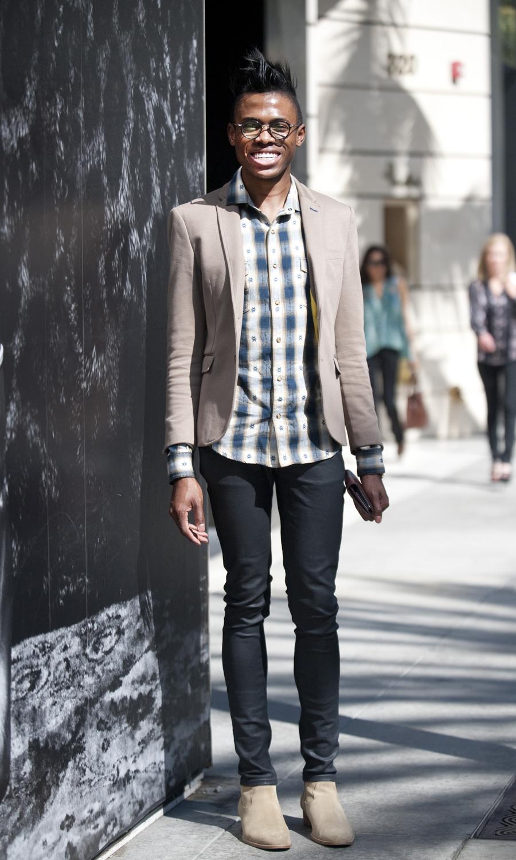 Deji Saka, 21, in a Zara blazer and shirt, YSL shoes, Nadie jeans and Movado watch.