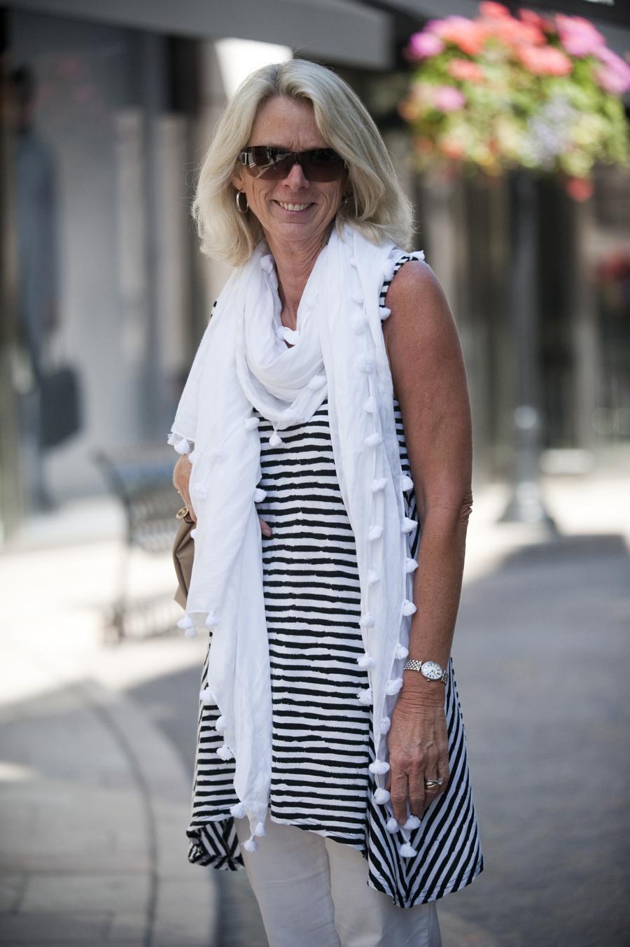Vicki Treblem, 56, from Sydney wearing a white scarf with pom poms.