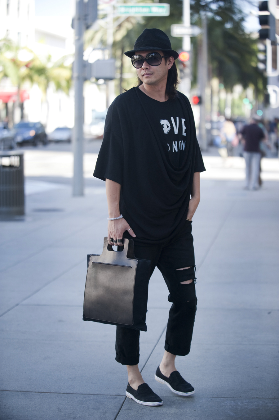 Tomo Iwanami, 34, wears a Libertine t-shirt and a bag from Junhashimoto.