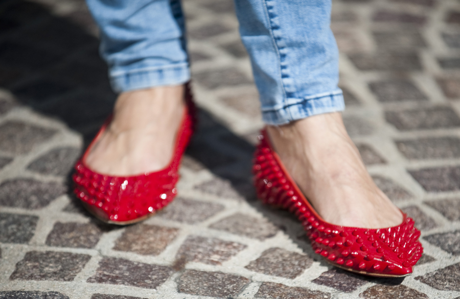 Pia Trans' red Pigalle Spiked Patent Leather Christian Louboutin Flats.