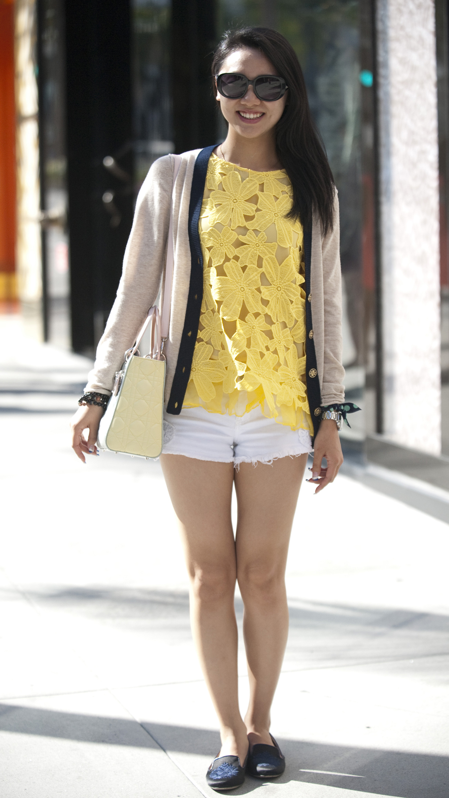 Tina Gou, 25, wears a yellow daisy-embroidered Love Me Me blouse.