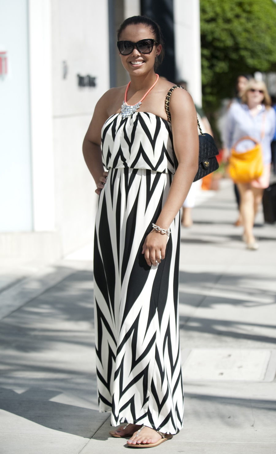 Danielle Kennedy, 28, wears a chevron-like Forever 21 maxi dress and necklace.
