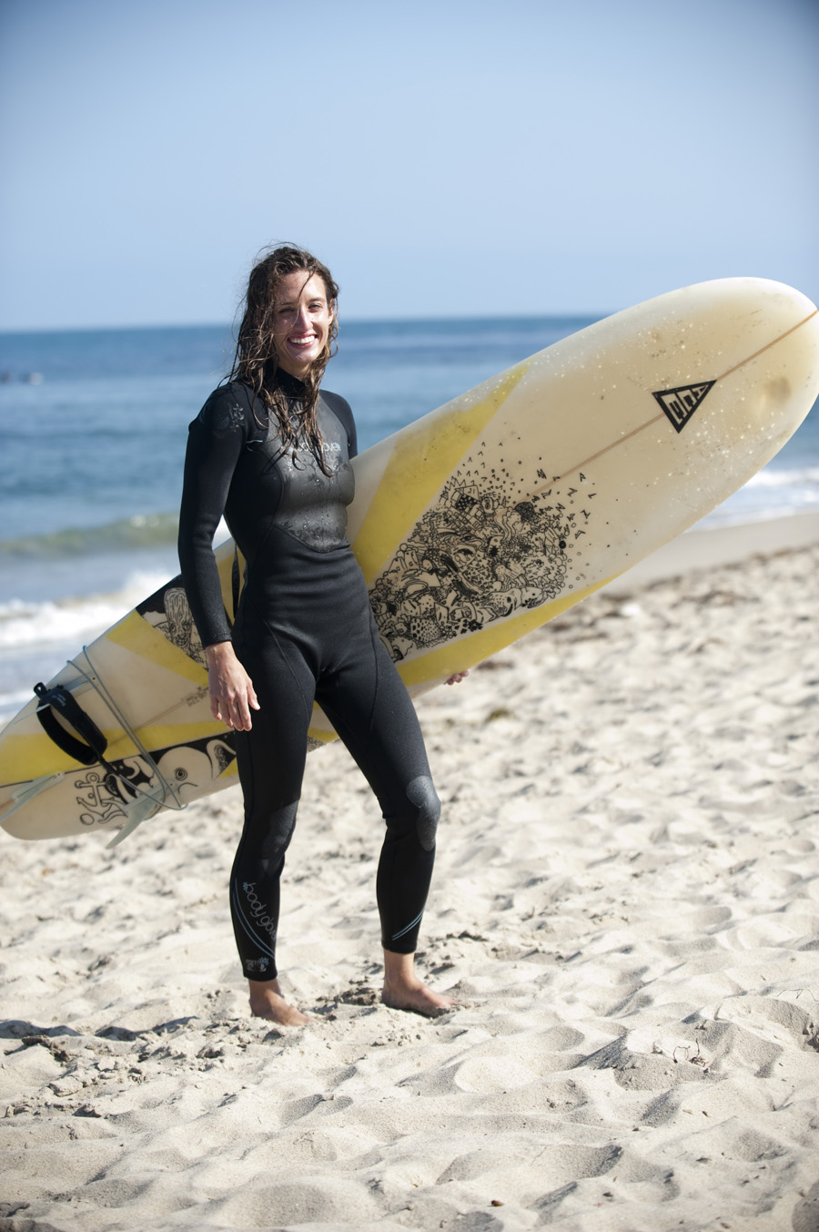 Megan Johnston wears a Body Glove wetsuit while surfing in Malibu.