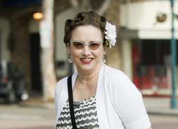 "Cher Maring, 44, in Seal Beach wearing an all vintage ensemble with cat-eye sunglasses, a white flower in her hair and a Bella Taylor purse. ""My look is very 40's,"" Maring said. ""I love Norma Shearer and classic movies."""