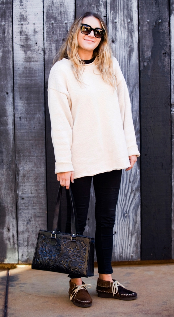 Avalon Sigalos, 26, was spotted at The LAB Animal wearing horse hair shoes from Mexico along with a tooled black leather shoulder bag, a cream sweater and oversized glasses from Thierry Lasry.