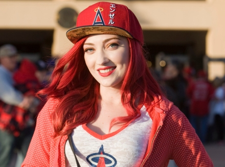 Hollie Forrest, 22, was spotted at the Angels game on Wednesday in Anaheim wearing an Angels baseball hat and T-shirt, white American Eagle jeans and Bite Beauty lipstick in the color Pomegranate.